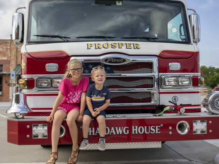 Kids sitting on Prosper Fire Truck