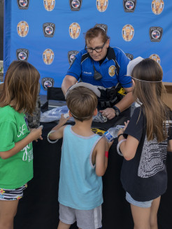 Prosper Police Officer helping kids